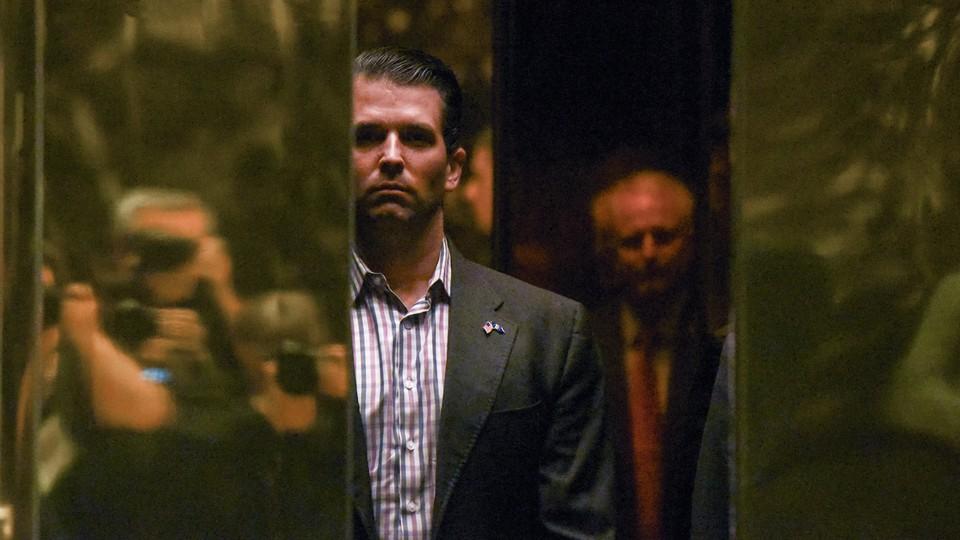 Donald Trump Jr. boards an elevator at Trump Tower