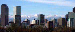 The skyline of Denver, with the Continental Divide seen in the background.