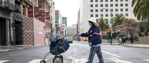 photo: A mail carrier makes her rounds in San Francisco in April.