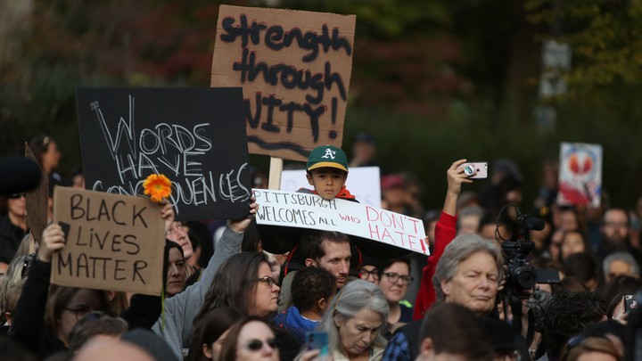 People march in memory of the victims of the Tree of Life synagogue shooting.