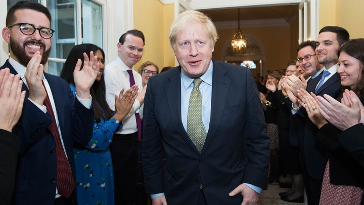 Boris Johnson arrives back at 10 Downing Street after visiting Buckingham Palace where he was given permission to form the next government during an audience with Queen Elizabeth II on December 13, 2019 in London, England