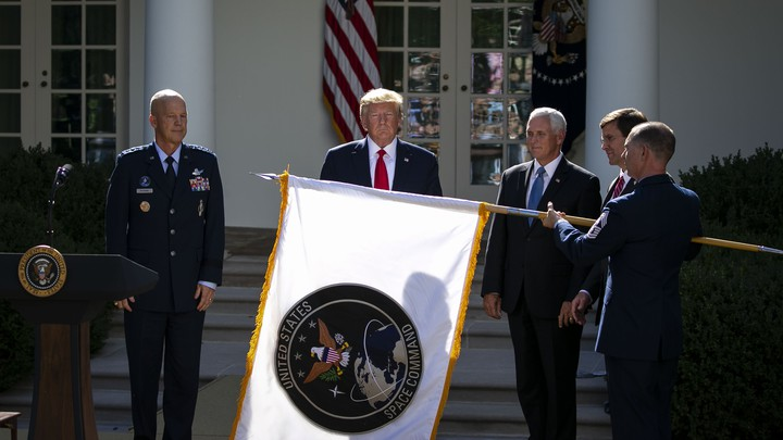 General Jay Raymond, now chief of space operations, stands with President Donald Trump in the Rose Garden.