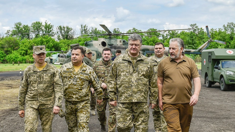 Ukrainian President Petro Poroshenko meets with servicemen during his visit to Donetsk region, Ukraine on June 14, 2017.
