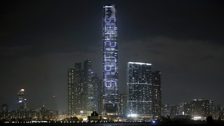 """A photo of the art installation """"Countdown Machine."""" A countdown to the year 2047 is projected onto the facade of Hong Kong's tallest skyscraper."""