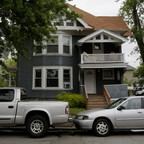 A house with two cars is pictured.