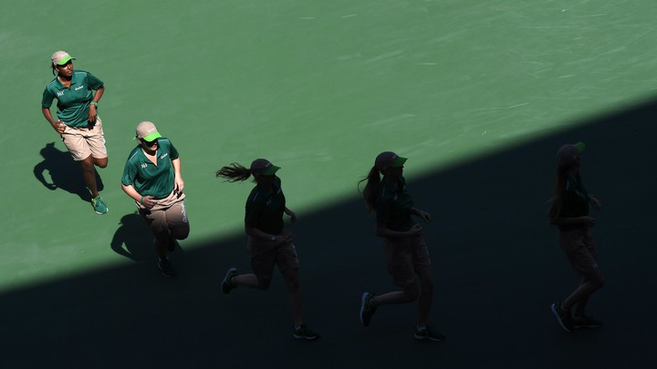 Five female tennis players are running.