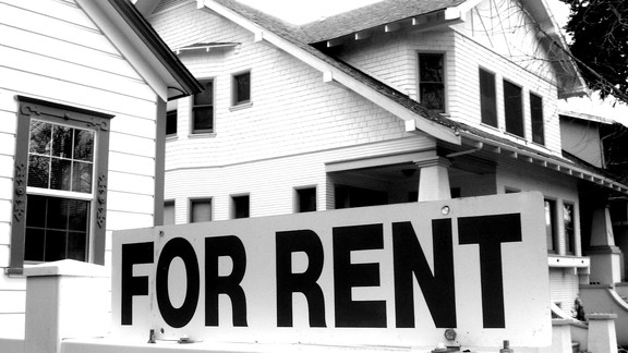 """House with a """"For Rent"""" sign."""
