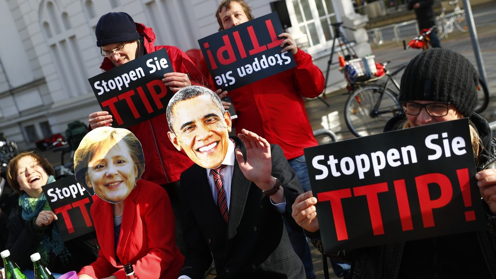 Protesters wear masks of U.S. President Barack Obama and German Chancellor Angela Merkel as they demonstrate against the TTIP in Hanover in April.