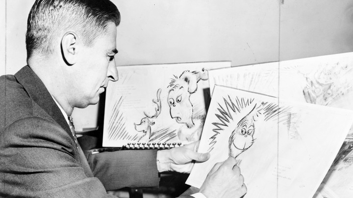 Theodor Seuss Geisel, American writer, poet, and cartoonist, at work on a drawing of a grinch.