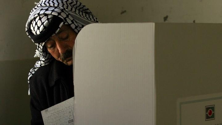 A Palestinian man casts his ballot.