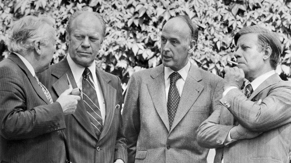 Gerald Ford, Harold Wilson, Valery Giscard d'Estaing, and Helmut Schmidt speaking with each other