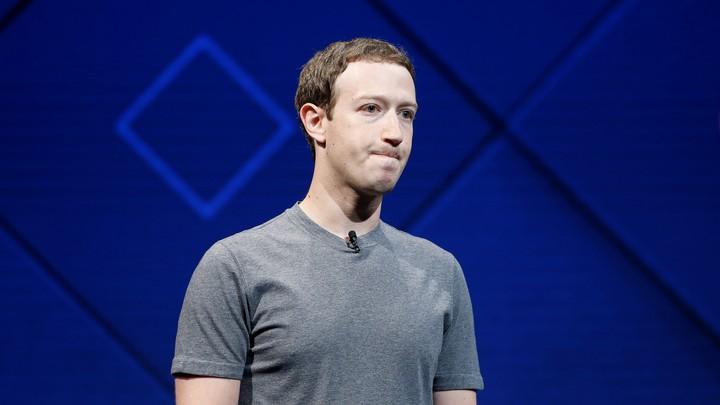 Mark Zuckerberg against a blue background