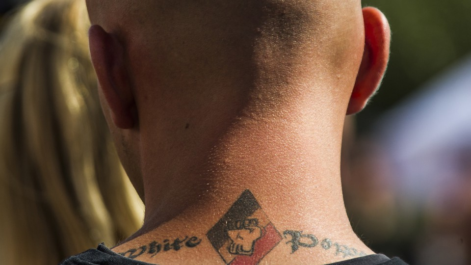 White power tattoo is seen at a far-right festival in the village of Viereck, north of Berlin.