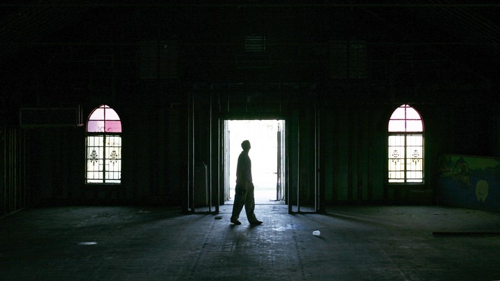 A man walks inside an empty church in the Ninth Ward area in New Orleans