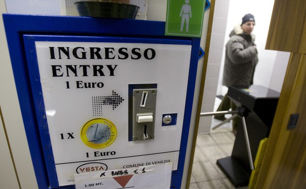A man leaves a pay toilet in Venice, Italy.