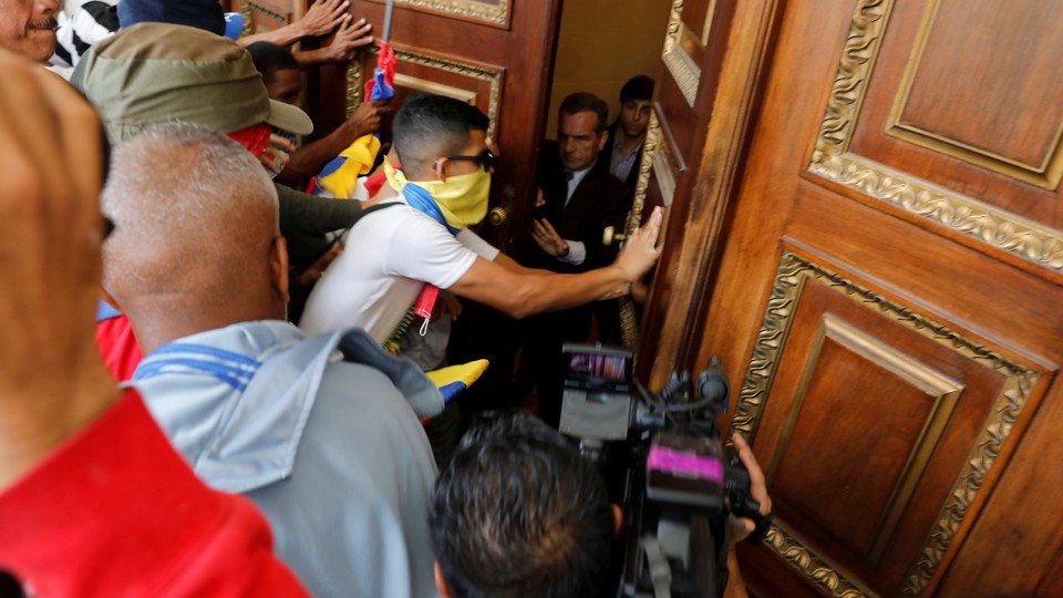 Government supporters try to enter Venezuela's opposition-controlled National Assembly on July 5, 2017.