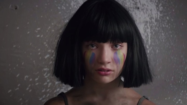 "Maddie Ziegler wears rainbow makeup in the video for ""The Greatest"""
