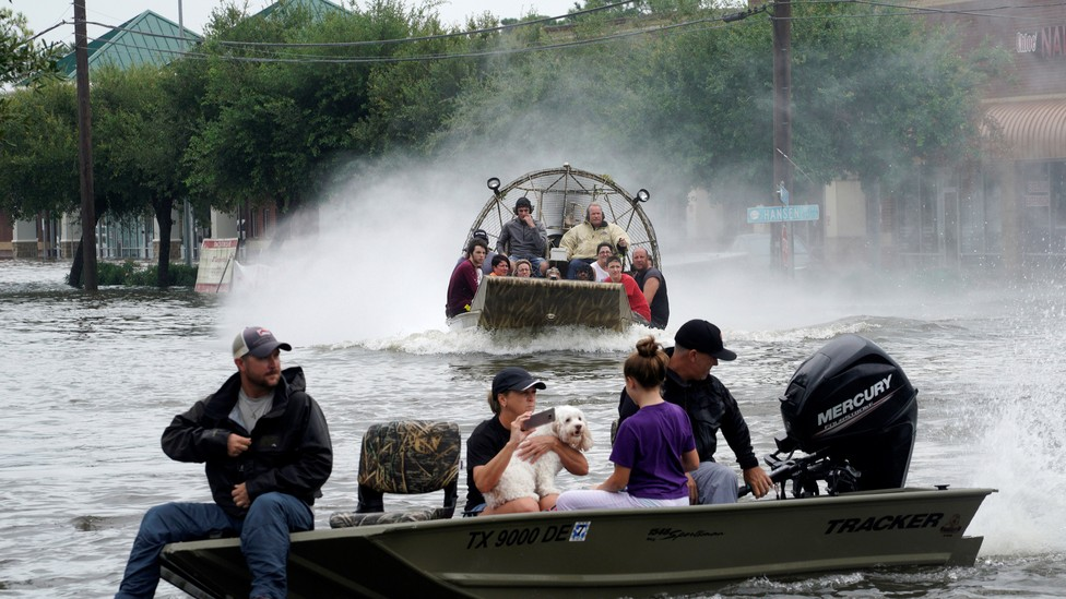 People are rescued from flood waters from tropical storm Harvey in Dickinson, Texas, on August 27, 2017.