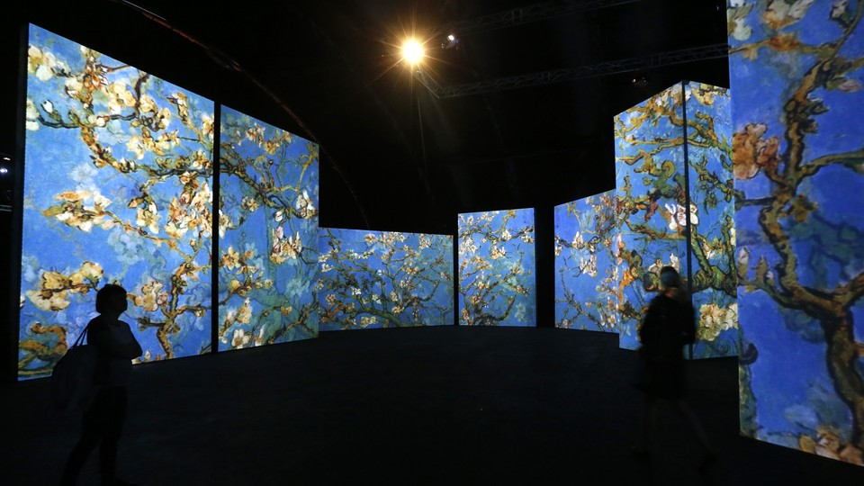 Several large projections of Van Gogh paintings