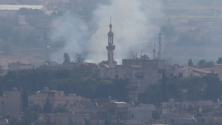 Smoke rises over the Syrian town of Ras al-Ain.
