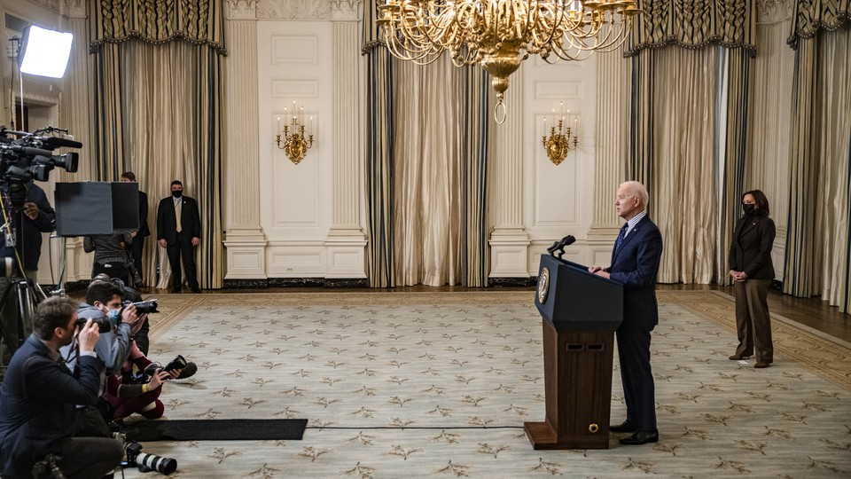President Joe Biden addresses cameras from a lectern
