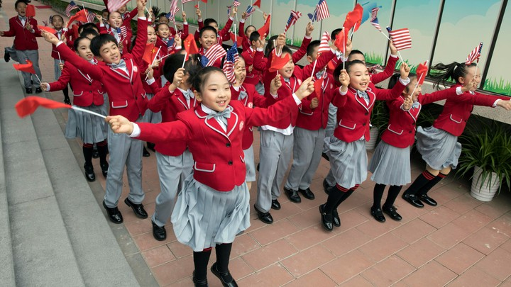 Chinese students wave U.S. and Chinese flags
