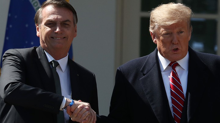 Donald Trump and Brazilian President Jair Bolsonaro shake hands after a news conference at the Rose Garden of the White House.