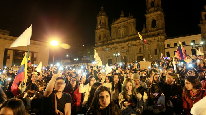 Supporters of the peace deal signed between the government and the FARC rebels gather at Bolivar Square during a march for peace in Bogota, Colombia on October 20, 2016.