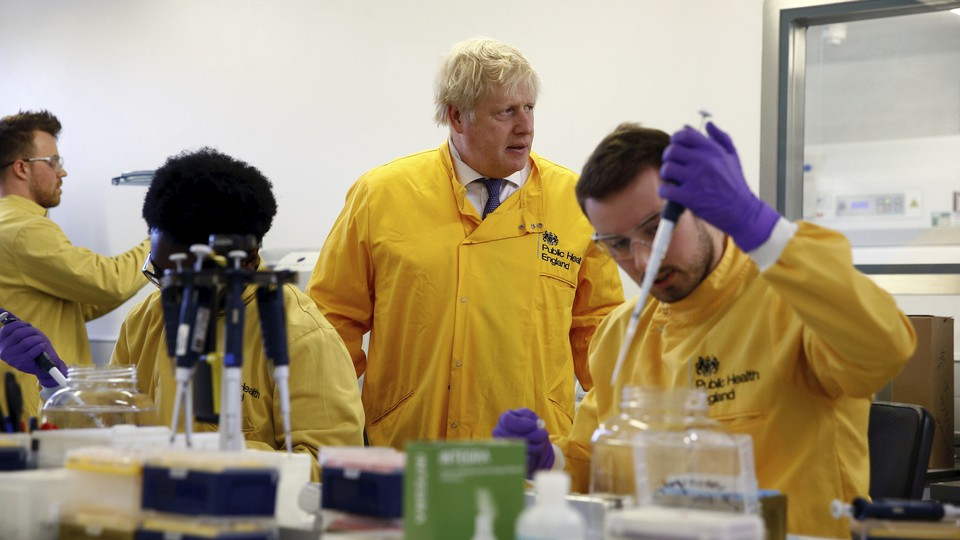 Britain's Prime Minister Boris Johnson visits a laboratory at the Public Health England National Infection Service.