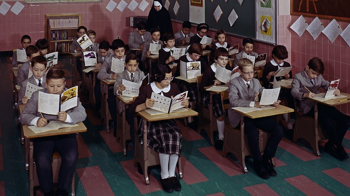 A group of students sits in a parochial-school classroom