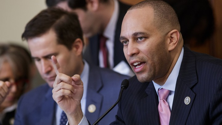 Representative Hakeem Jeffries of New York speaks into a microphone