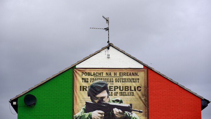 A mural in the Ardoyne area of North Belfast displaying an image of an IRA gunman
