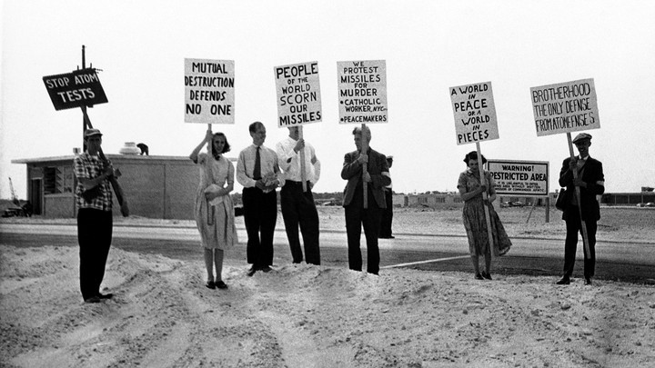 A black-and-white photo of antinuclear protesters holding signs in Cape Canaveral, Florida