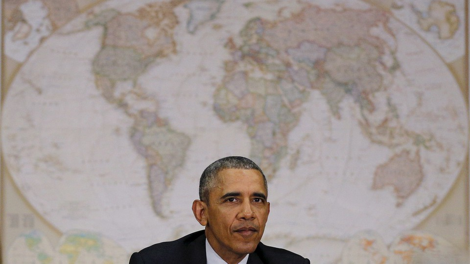 Sitting in front of a world map, U.S. President Barack Obama attends a meeting with the National Security Council at the State Department in Washington February 25, 2016.