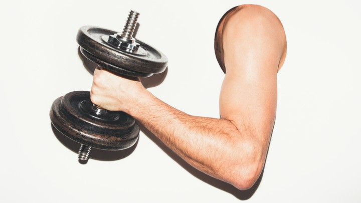 A man's arm holding a dumbbell