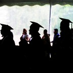 A photo of graduating college seniors in caps and gowns during commencement.