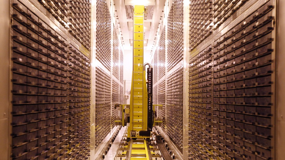 Yellow robot moving through storage freezer