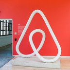 A sculpture of the Airbnb logo is pictured.