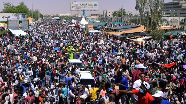 Sudanese demonstrators chant slogans during a protest in Khartoum demanding that Sudanese President Omar Al-Bashir step down.