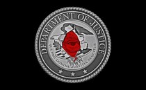 An illustration of the Department of Justice seal with Donald Trump's eye.