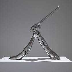 photo of 'Strike' (2018) by Hank Willis Thomas: a sculpture of one arm holding another arm with a baton