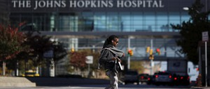 A person walks past the Johns Hopkins Hospital in Baltimore.