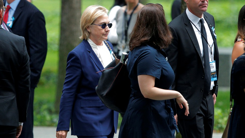 Hillary Clinton on the sidewalk outside her daughter's apartment Sunday