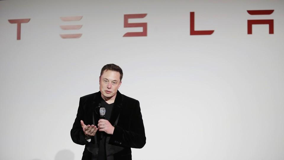Elon Musk gives a presentation at Tesla