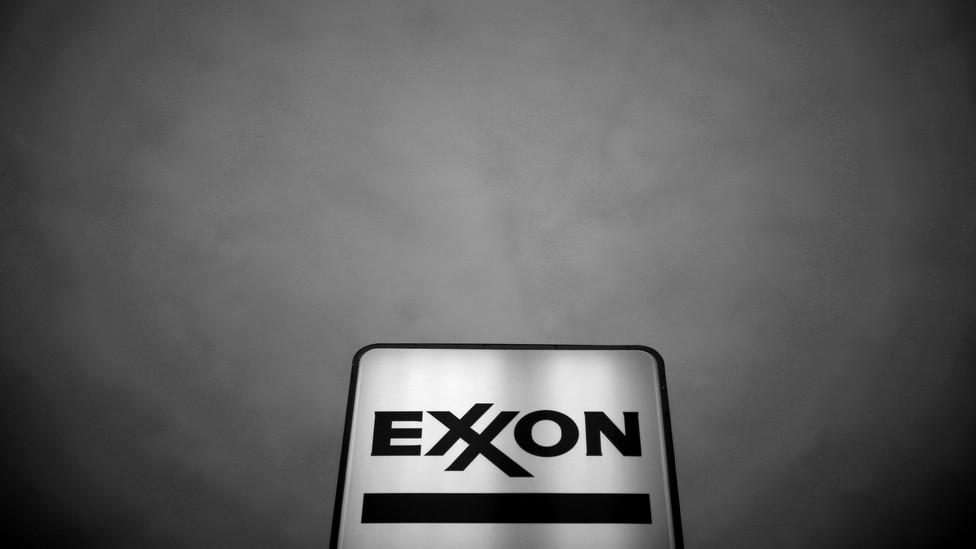 An Exxon sky lit against a black sky