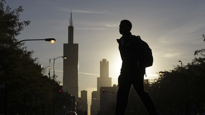 A student walks to high school in Chicago.