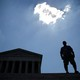 A man stands outside the U.S. Supreme Court after the Court ruling on June 27.
