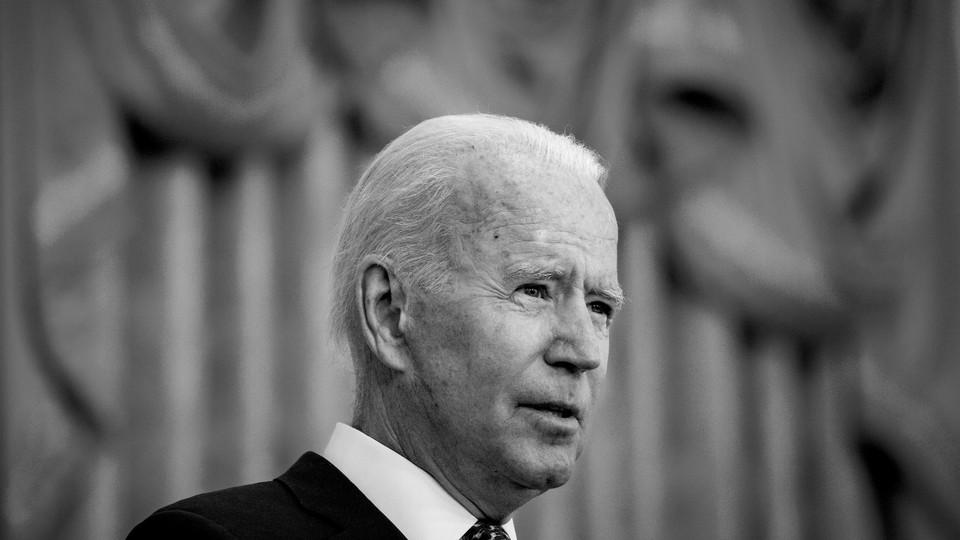 Joe Biden looks out from a podium.