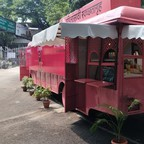 A bright-pink bus, converted into a mobile restroom, awaits customers in the Indian city of Pune.