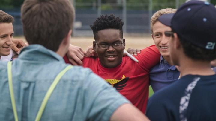 Kendale McCoy (center), a student at Oak Park High School